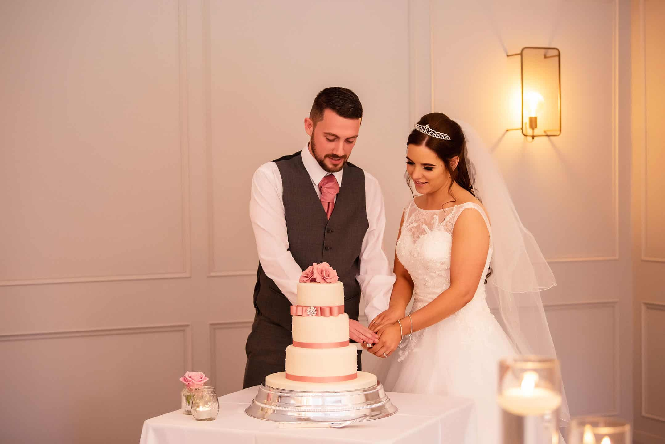 Manchester Wedding Photography at Room One Hartford cutting cake